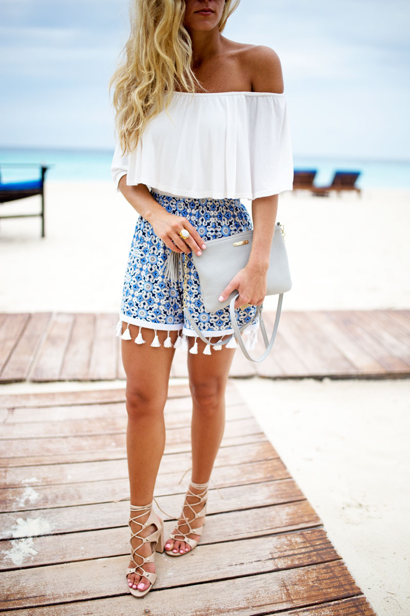 off-shoulder-ruffle-top-tassel-shorts-resort-outfit-cancun-beach-style