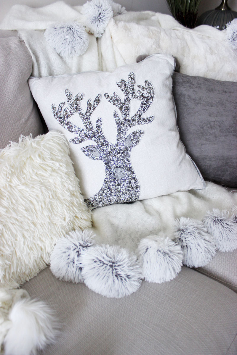 pom pom blanket with reindeer pillow