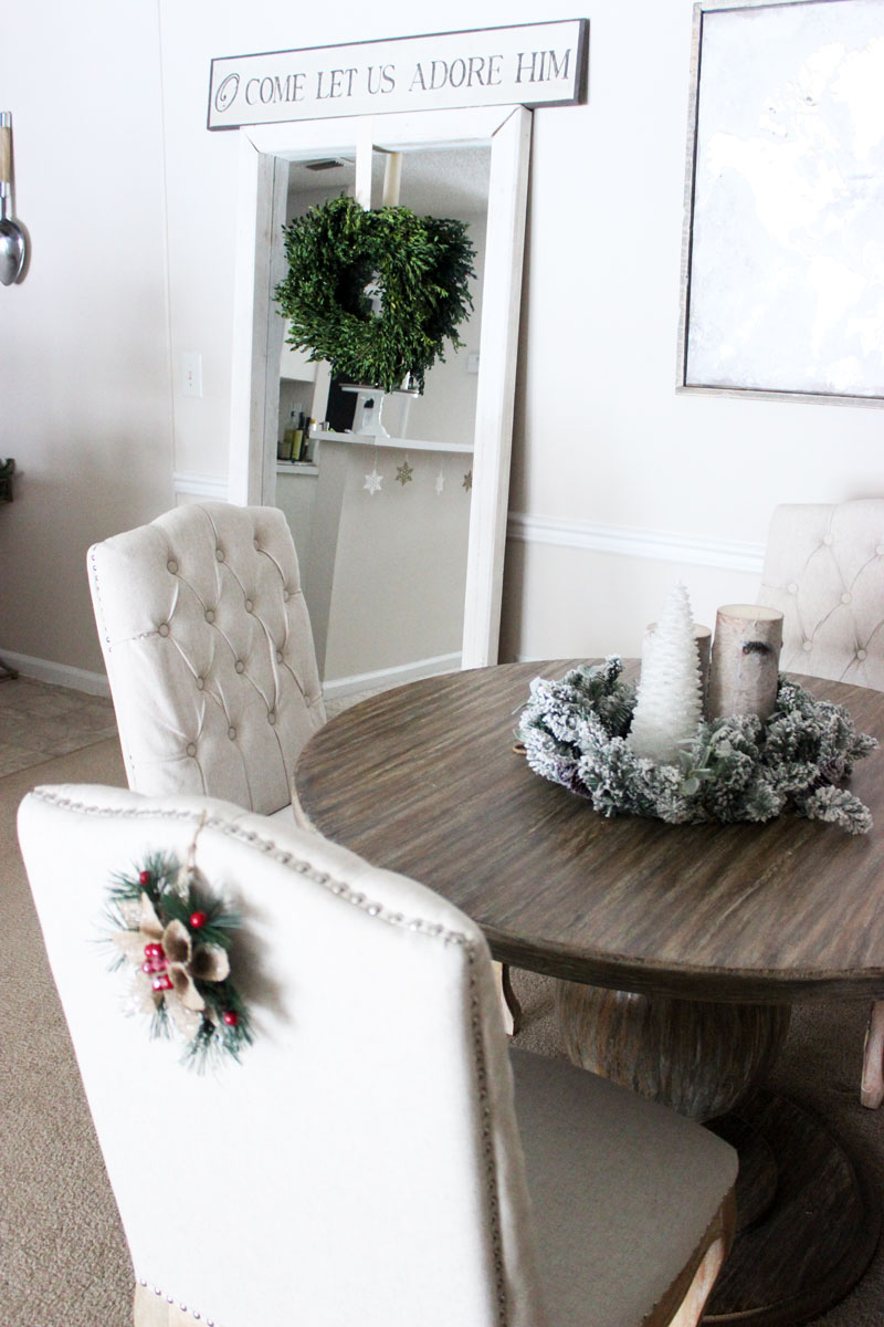 rustic-farmhouse-dining-room-area-holiday-home-tour-boxwood-wreath-floor-length-mirror-joss-and-main-dining-chairs-round-world-market-table