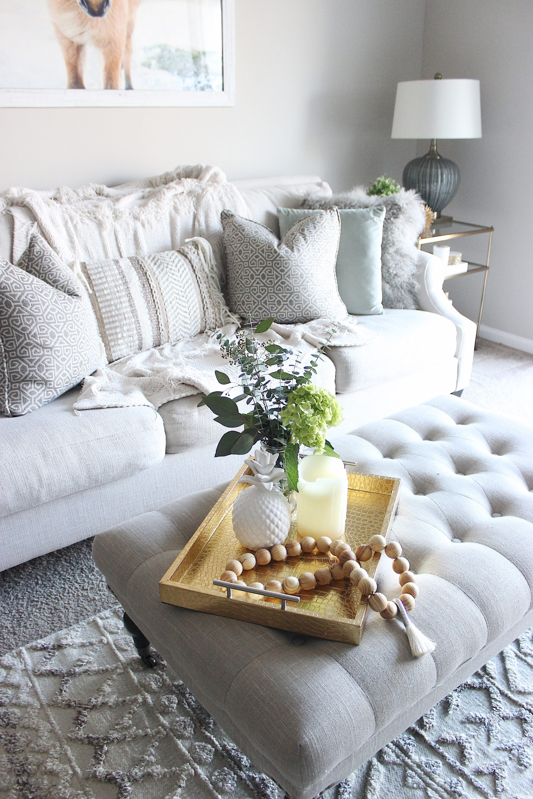 tufted ottoman neutral pillow living room style